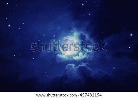 Night blue sky with full moon, bright stars and fluffy clouds