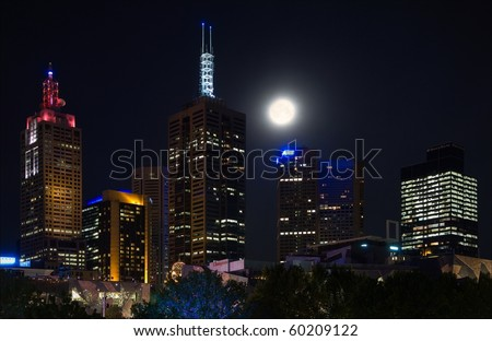Night Brisbane. A night city in a full moon with burning fires, signboards, lanterns... - stock photo