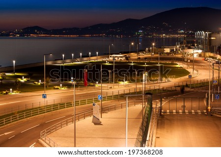 Night city Adler on the Black sea , in the background-lights Sochi - stock photo