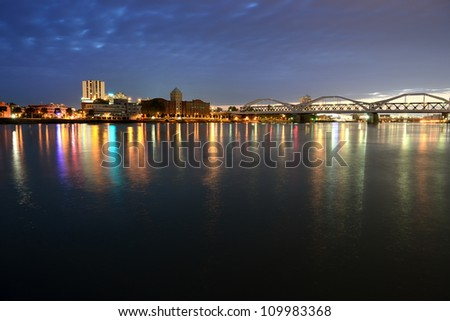 Night city and bridge across river