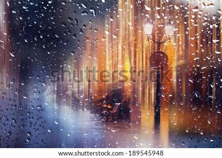 Night city blurred landscape lantern bench  - stock photo