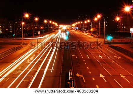 Night city Brest (Belarus) in the lights and the track headlights from cars
