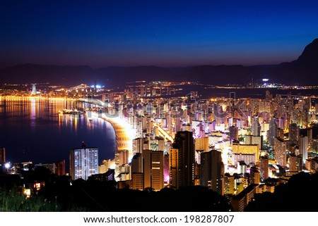 Night city by the sea with an empty beach and beautiful night lighting (Sunset in Spain, Benidorm)