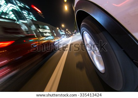 Night city from the car back view. - stock photo