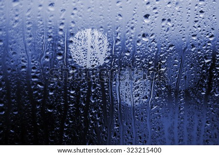 Night city life through windscreen: darkness and rain - stock photo