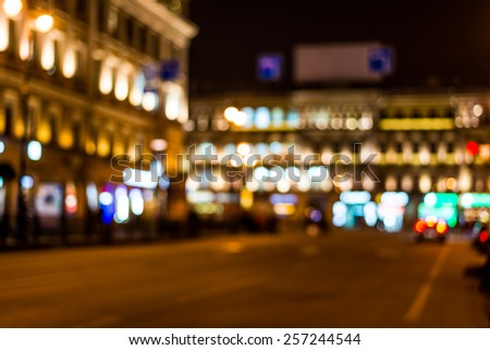 Night city, night life on the streets, the buildings in lights in the background - stock photo