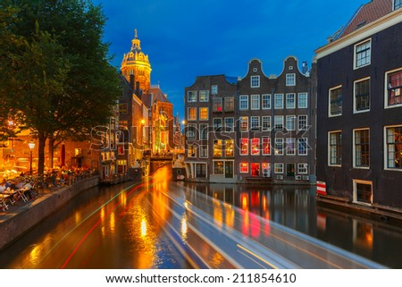 Night city view of Amsterdam canal, bridge and luminous track from the boat, Holland, Netherlands. Long exposure.  - stock photo