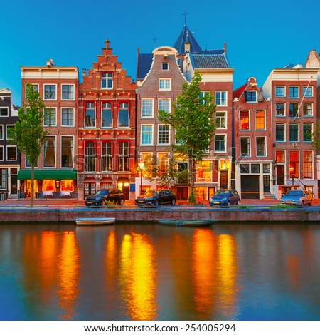 Night city view of Amsterdam canal Herengracht, typical dutch houses and boats, Holland, Netherlands.  - stock photo