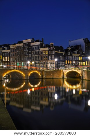 Night city view of Amsterdam, the Netherlands with a canal - stock photo