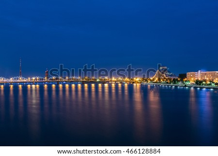 Night Cityscape Of Riga, Latvia. View On The National Library Of Latvia. Riga Radio & Tv Tower. Seafront. Copyspace. Travel Destination. Nobody.
