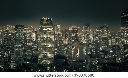 Night cityscape of TOKYO City taking on top of Tokyo building in Tokyo . - stock photo
