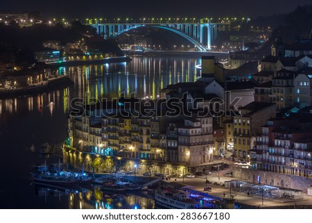 night cityscape view city of Porto and Douro river in Portugal - stock photo