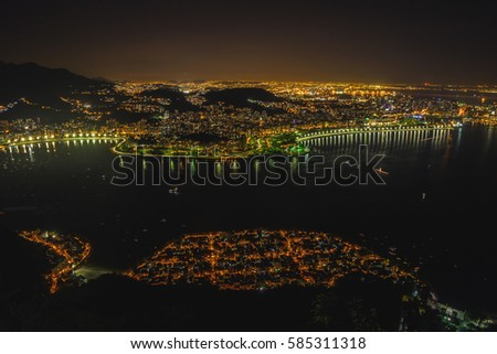 Night cityscape view from the Sugarloaf mountain on the Guanabara bay, Botafogo and Flamengo beach and district, Urca district. Rio de Janeiro, Brazil.