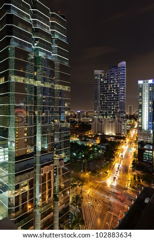 Night cityscape view of the Brickell Avenue area in downtown Miami with office buildings and skyscraper condominiums. - stock photo