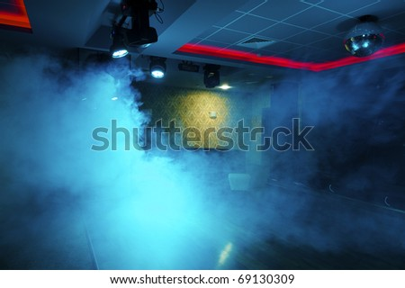 Night club interior with colorful spot lights - stock photo