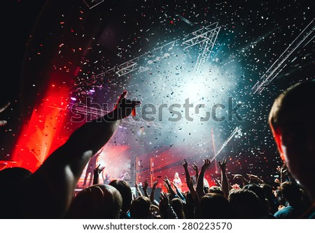 Night club party crowd hands up - stock photo