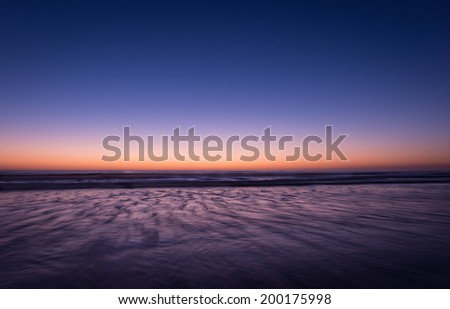 Night colors of the ocean, beach and sky. Long exposure - stock photo