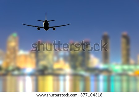 Night (dawn, dusk ) flight of the airplane (jet) over the beautiful night sky and city over ocean. - stock photo