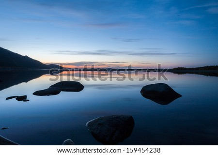Night descends on the Pike Lake, northern Kazakhstan, shooting with a slow shutter speed and flash - stock photo