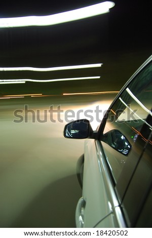 night drive with car in motion through the city shows the speed - stock photo