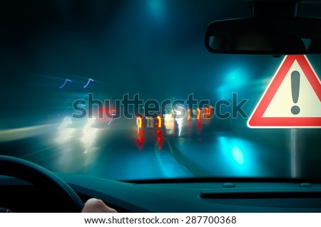Night Driving - bad weather driving - night driving - caution - stock photo