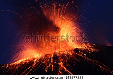 Night eruption volcano Stromboli  Glowing rocks falling down in Phase2 - stock photo