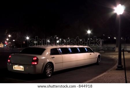 Night escort (limousine at night ) - stock photo