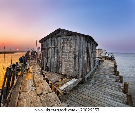 Night falling in Carrasqueira.Palaphitic pier,fisherman hut.Portugal.