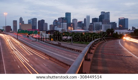 Night falls as rush hour winds down in Houston, Texas - stock photo