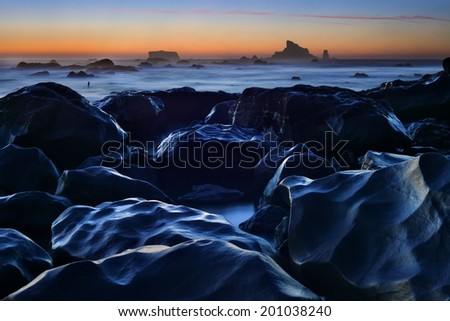 Night falls on tide pools and rocks at Rialto Beach in Olympic National Park, Washington, USA - stock photo