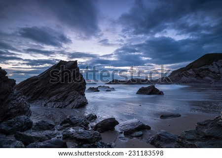 Night falls over the Cornwall Coast at Sharrow beach on Whitsand Bay - stock photo