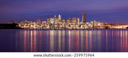 Night falls showing reflections in the smooth water of Elliott Bay - stock photo