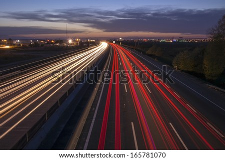 Night highway with long exposure. - stock photo