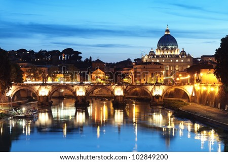 Night image of River Tiber, including: Ponte Sant Angelo and St. Peter's Basilica in the background. Rome - Italy - stock photo