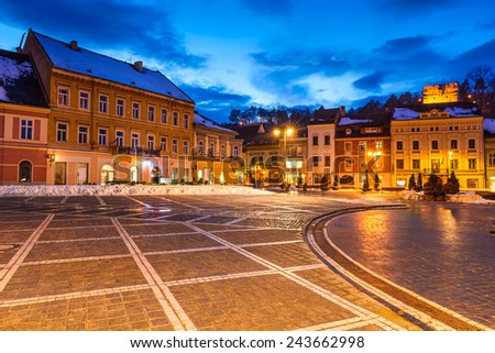 Night image with downtown of Brasov medieval city in Transylvania, Romania and Tampa mountain its landmark. - stock photo