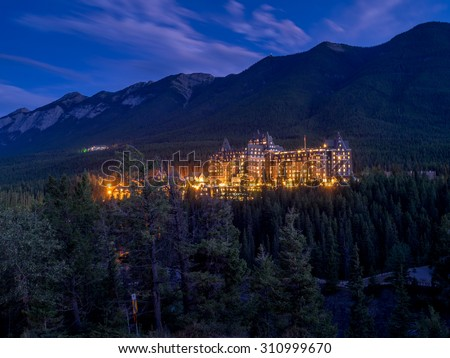 Night in Banff National Park with the Banff Springs Hotel in the distance.  - stock photo