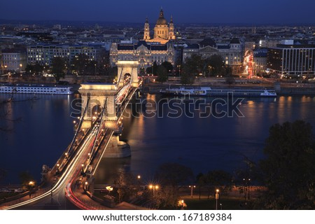Night In Budapest With The Famous Chain Bridge Light Up With Traffic Crossing The Danube River - stock photo