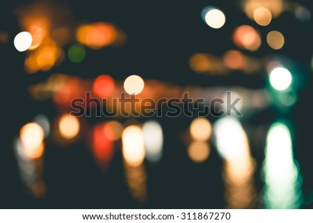 Night in city ray lights bokeh glitter defocused abstract background vintage color tone. - stock photo