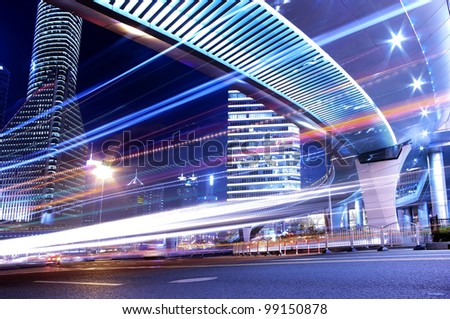 Night in Shanghai, China, construction and traffic light trails - stock photo