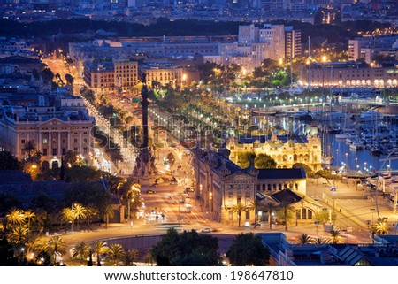 Night in the city of Barcelona in Catalonia, Spain. Columbus Monument and boulevard along Port Vell. - stock photo