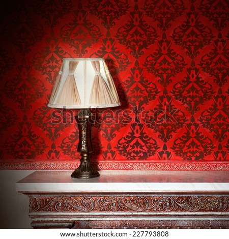 Night lamp in vintage interior with red pattern walls - stock photo
