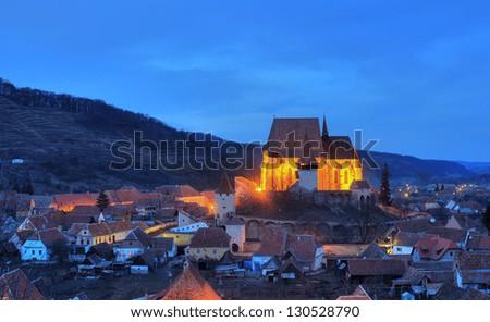 Night landscape of Biertan village, Transylvania, Romania - stock photo
