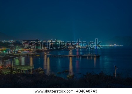 Night landscape of the Black Sea resort of lights on the waterfront