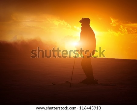 Night landscape with silhouette skier