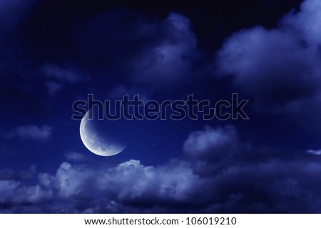 Night landscape with the moon in a cloudy sky - stock photo