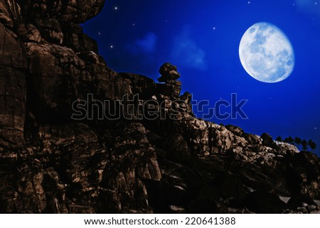 Night landscape with the moon over the rocks
