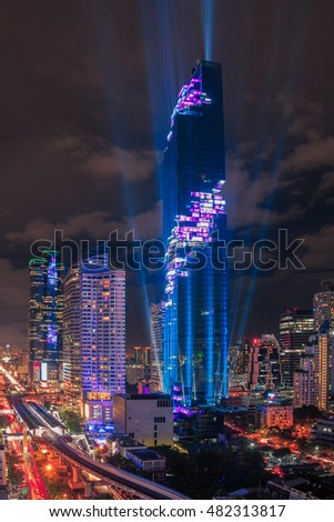 Night light of Bangkok. Traffic And sky train,  High rise building skyscraper commercial of future. Business concept of success industry tech architecture.