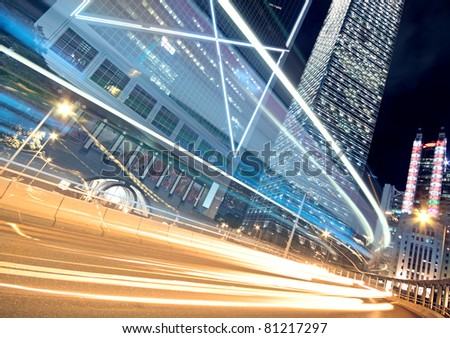Night Light trace modern architecture background in hongkong, China. - stock photo