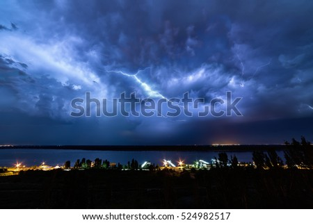 Night lightning over the river