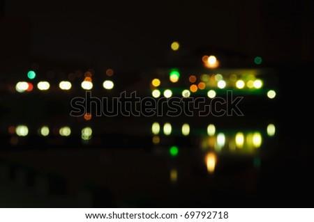 night lights with blur in dark city - stock photo